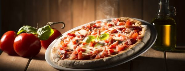 Pizza with bacon on the wooden table