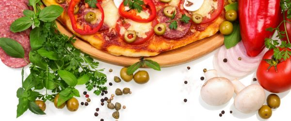 Pizza with mushrooms, sausage and vegetables on a white background.